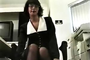 older woman masturbating in her office
