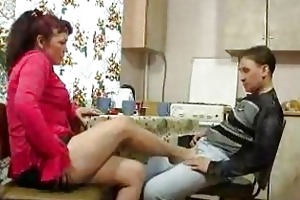 older woman and youthful lad fucking on kitchen