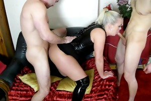 sexy brit cougar in leather and boots takes couple