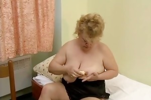 wicked overweight housewife rubs a banana on her