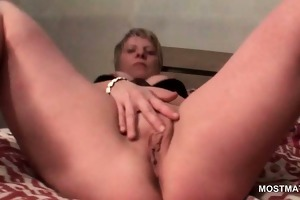 mature tramp in leather boots finger fucking