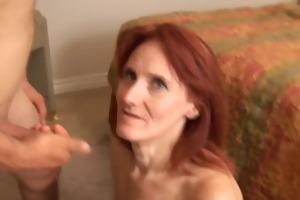 debra is a slender older redhead who loves the