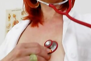milada, the sexy mom nurse, examines her pink